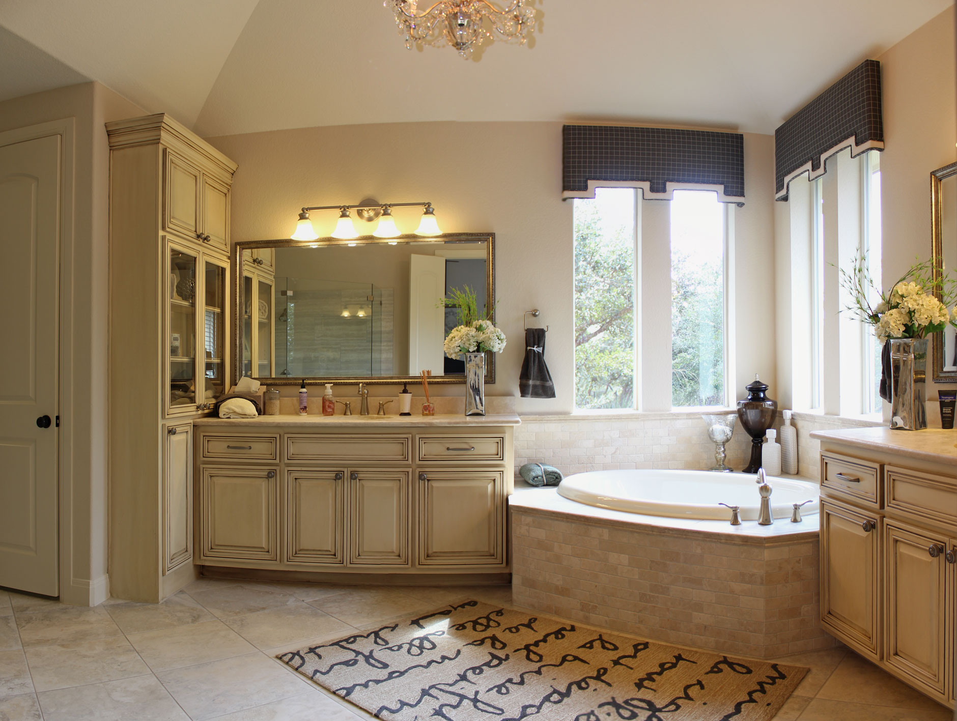 master bath cabinets in bone white with tall glass door cabinet