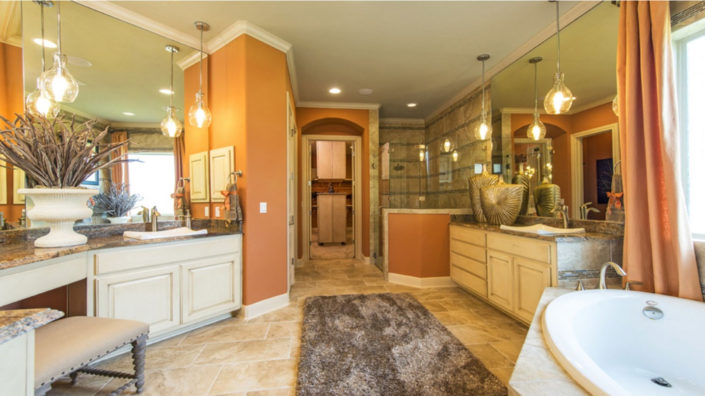 Master bath cabinets with raised panel doors in bone by Burrows Cabinets