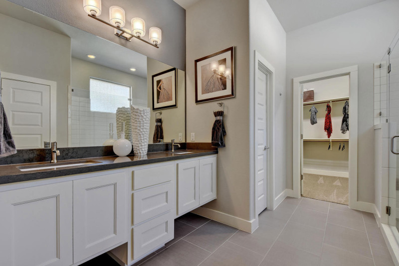 Burrows Cabinets' master bath with door style Terrazzo in Bone