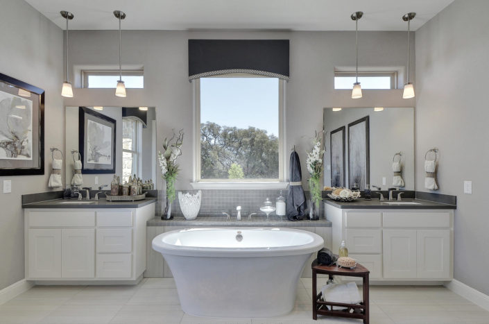 Burrows Cabinets' master bath cabinets with shaker doors in bone white