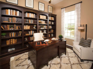 Study with built in bookshelves with Kona finish by Burrows Cabinets