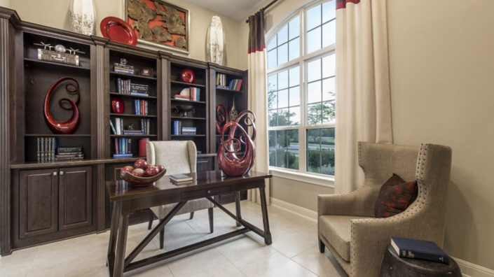 Burrows Cabinets' built in study bookshelves and cabinets in Knotty Alder Kona