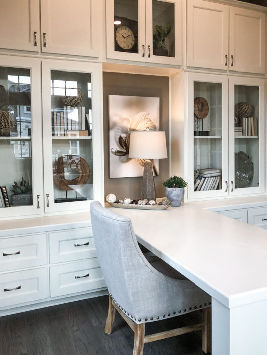 Burrows Cabinets' built-in study cabinets in Bone white with Terrazzo doors