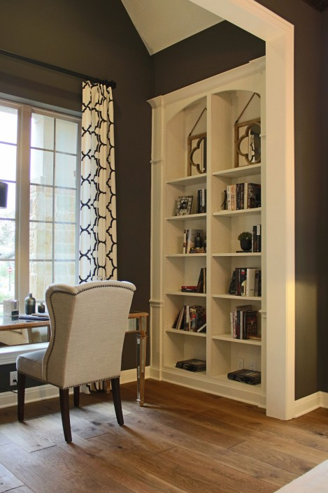 Burrows Cabinets' built-in bookshelves with arched top in bone white