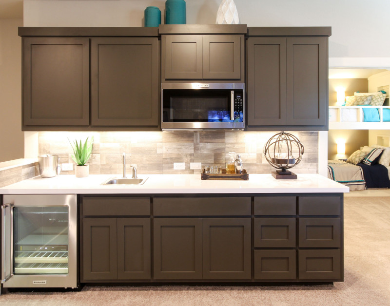 Burrows Cabinets' wet bar in Umber with Shaker doors